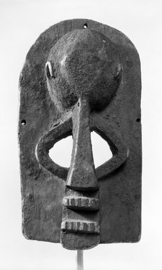 Dogon. <em>Mask of Hunter with Bulbous Forehead</em>, late 19th or early 20th century. Wood, 13 1/4 x 6 1/2 x 6 1/2 in. (33.6 x 16.5 x 16.5 cm). Brooklyn Museum, Gift of Mr. and Mrs. J. Gordon Douglas III, 78.115.1. Creative Commons-BY (Photo: Brooklyn Museum, 78.115.1_bw.jpg)