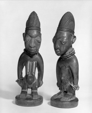 Yorùbá artist. <em>Male twin figure (Ère Ìbejì)</em>, late 19th or early 20th century. Wood, beads, metal, pigment, 11 x 3 1/2 x 3 in. Brooklyn Museum, Gift of Mr. and Mrs. Paul B. Taylor, 78.118.1. Creative Commons-BY (Photo: , 78.118.1_78.118.2_bw.jpg)