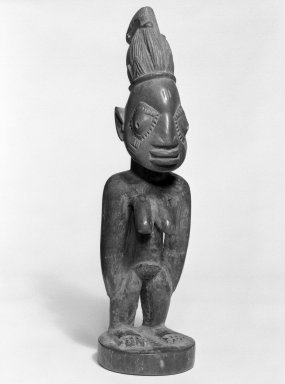 Yorùbá artist. <em>Female twin figure (Ère Ìbejì)</em>, late 19th or early 20th century. Wood, pigment, 11 x 3 x 3 1/4 in. Brooklyn Museum, Gift of Mr. and Mrs. Paul B. Taylor, 78.118.3. Creative Commons-BY (Photo: Brooklyn Museum, 78.118.3_bw.jpg)