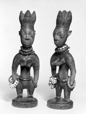 Yorùbá artist. <em>Female twin figure (Ère Ìbejì)</em>, late 19th or early 20th century. Wood, pigment, beads, cowrie shells, metal, patina, 10 3/4 x 3 1/4 x 3 in. Brooklyn Museum, Gift of Mr. and Mrs. Paul B. Taylor, 78.118.4. Creative Commons-BY (Photo: , 78.118.4_78.118.5_bw.jpg)