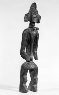 Mumuye. <em>Standing Figure</em>, 20th century. Wood, copper alloy, hide, kaolin, 23 1/4 x 5 x 4 1/4in. (59.1 x 12.7 x 10.8cm). Brooklyn Museum, Gift of Mr. and Mrs. Paul B. Taylor, 78.118.7. Creative Commons-BY (Photo: Brooklyn Museum, 78.118.7_bw.jpg)