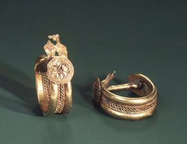 Phoenician. <em>Pair of Earrings</em>, 6th century-5th century B.C.E. Gold, bronze, 1 7/8 x 9/16 in. (4.7 x 1.5 cm). Brooklyn Museum, Caroline H. Polhemus Fund, 78.134a-b. Creative Commons-BY (Photo: Brooklyn Museum, 78.134_transp2684.jpg)