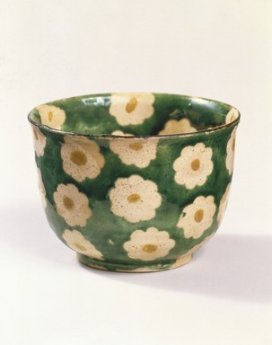 Ogata Kenzan (Japanese, 1663-1743). <em>Mukozuke (Sweetmeat dish)</em>, 18th century. Stoneware with enamel background and paper-resist blossoms with enamel centers, 2 3/16 x 3 1/8 in. (5.6 x 7.9 cm). Brooklyn Museum, Purchase gift of the J. Aron Charitable Foundation, Inc., 78.208. Creative Commons-BY (Photo: Brooklyn Museum, 78.208_edited_version_SL1.jpg)