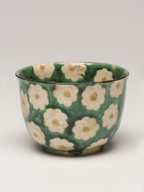 Ogata Kenzan (Japanese, 1663-1743). <em>Mukozuke (Sweetmeat dish)</em>, 18th century. Stoneware with enamel background and paper-resist blossoms with enamel centers, 2 3/16 x 3 1/8 in. (5.6 x 7.9 cm). Brooklyn Museum, Purchase gift of the J. Aron Charitable Foundation, Inc., 78.208. Creative Commons-BY (Photo: Brooklyn Museum, 78.208_view01_PS11.jpg)