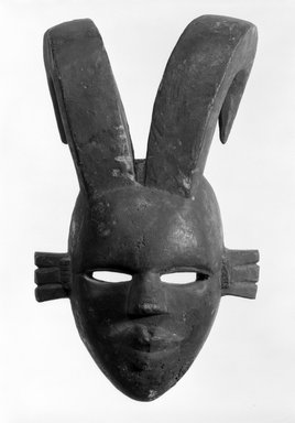 Ogoni. <em>Mask with Two Curved Horns</em>, early 20th century. Wood, 12 1/2 x 8 x 5 in. (31.8 x 20.3 x 12.6 cm). Brooklyn Museum, Gift of the Edwards-Britt Collection, 78.238.2. Creative Commons-BY (Photo: Brooklyn Museum, 78.238.2_bw.jpg)