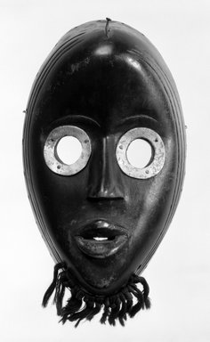 Dan. <em>Gunyega Mask</em>, late 19th-early 20th century. Wood, metal, 8 7/8 x 5 1/2 x 3 in. (22.5 x 14 x 7.6 cm). Brooklyn Museum, Gift of the Edwards-Britt Collection, 78.238.3. Creative Commons-BY (Photo: Brooklyn Museum, 78.238.3_bw.jpg)