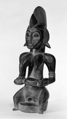 Senufo. <em>Seated Female Figure with Child Nursing</em>, mid-20th century. Wood, 17 1/2 x 6 3/4 x 6 in. (44.5 x 17.2 x 15.2 cm). Brooklyn Museum, Gift of Kaywin Lehman Smith, 78.241. Creative Commons-BY (Photo: Brooklyn Museum, 78.241_bw.jpg)