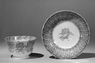 American Pottery Company (probably) (1833-1845). <em>Cup and Saucer</em>. Spatterware, H. of cup: 2 1/2 in. (6.4 cm). Brooklyn Museum, Gift of Allison C. Paulsen in memory of Arthur W. Clement, 78.242.30a-b. Creative Commons-BY (Photo: Brooklyn Museum, 78.242.30a-b_bw.jpg)