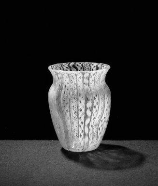 <em>Vase, blown Latticino filigree</em>, ca. 1880. Sandwich glass, H: 3 9/16 in. (9 cm). Brooklyn Museum, Gift of Allison C. Paulsen in memory of Arthur W. Clement, 78.242.6. Creative Commons-BY (Photo: Brooklyn Museum, 78.242.6_bw.jpg)