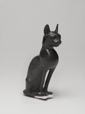 <em>Cat (Bastet)</em>, 664-343 B.C.E. Bronze, 5 1/4 x 1 5/8 x 3 3/4 in. (13.3 x 4.1 x 9.5 cm). Brooklyn Museum, Gift of Mrs. Nasli Heeramaneck, 78.243. Creative Commons-BY (Photo: , 78.243_threequarter_PS9.jpg)