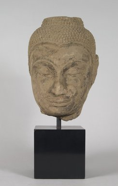 <em>Head of a Buddha</em>, 17th century. Stone, 11 x 7 1/2 x 5 in.  (27.9 x 19.1 x 12.7 cm). Brooklyn Museum, Gift of Anthony A. Manheim, 78.258.1. Creative Commons-BY (Photo: Brooklyn Museum, 78.258.1_PS5.jpg)