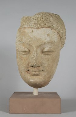<em>Head of a Buddha</em>, ca. 4th-5th century. Stucco, height: 12 5/8 in.  (32.1 cm). Brooklyn Museum, Gift of Paul E. Manheim, 78.259.2. Creative Commons-BY (Photo: Brooklyn Museum, 78.259.2_PS5.jpg)