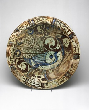 <em>Bowl with Peacock Motif</em>, ca. 1200–1230. Ceramic; fritware, painted in luster on a transparent glaze with touches of cobalt blue, 4 1/8 x 14 3/16 in. (10.5 x 36 cm). Brooklyn Museum, Gift of Mr. and Mrs. Carl L. Selden, 78.81. Creative Commons-BY (Photo: Brooklyn Museum, 78.81_SL1.jpg)