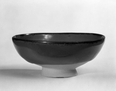 Koyama Fujio (Japanese). <em>Sake Cup</em>, 1968. Persimmon-glazed stoneware, 1 1/4 x 3 1/8 in. (3.2 x 7.9 cm). Brooklyn Museum, Gift of Robert H. Ellsworth, 78.84.2. Creative Commons-BY (Photo: Brooklyn Museum, 78.84.2_bw.jpg)