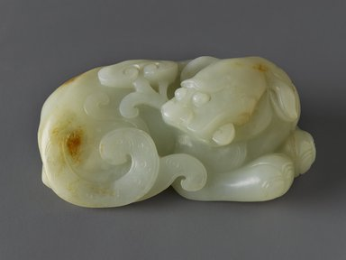 <em>Carving of a Recumbent Mythical Beast</em>, late 18th-early 19th century. Nephrite, 1 3/8 x 3 1/2 in. (3.5 x 8.9 cm). Brooklyn Museum, Gift of Stanley Herzman, 78.85.7. Creative Commons-BY (Photo: Brooklyn Museum, 78.85.7_PS4.jpg)