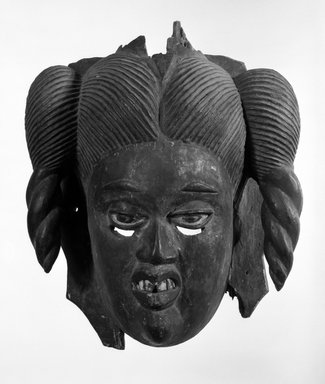 Akpan Chuku (or predecessor) (Ibibio (Anang)). <em>Female Masquerade Mask</em>, early 20th century. Wood, pigment, 14 1/2 x 11 1/2 x 6 1/2 in. (37.0 x 29.2 x 16.5 cm). Brooklyn Museum, Gift of Dr. Ernst Anspach, 79.115.2. Creative Commons-BY (Photo: Brooklyn Museum, 79.115.2_bw.jpg)