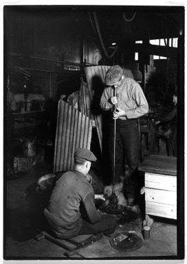 Lewis Wickes Hine (American, 1874-1940). <em>[Untitled] (Blowing into Mold)</em>, 1936-1937. Gelatin silver photograph, 7 x 5 in.  (17.8 x 12.7 cm). Brooklyn Museum, Gift of The National Archives, 79.143.104 (Photo: Brooklyn Museum, 79.143.104_bw.jpg)