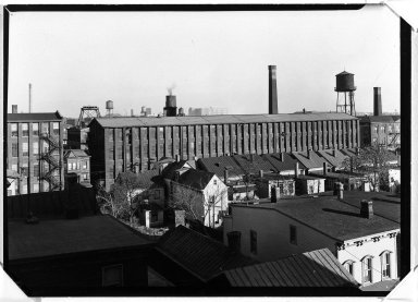 Lewis Wickes Hine (American, 1874-1940). <em>[Untitled] (Factory and Houses)</em>, ca. 1937-1938. Gelatin silver photograph, 4 3/4 x 7 1/4 in.  (12.1 x 18.4 cm). Brooklyn Museum, Gift of The National Archives, 79.143.12 (Photo: Brooklyn Museum, 79.143.12_bw.jpg)