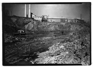 Lewis Wickes Hine (American, 1874-1940). <em>[Untitled] (Steel Mill with Excavation and Railroad Tracks)</em>, 1936-1937. Gelatin silver photograph, 5 x 7 in.  (12.7 x 17.8 cm). Brooklyn Museum, Gift of The National Archives, 79.143.169 (Photo: Brooklyn Museum, 79.143.169_bw.jpg)
