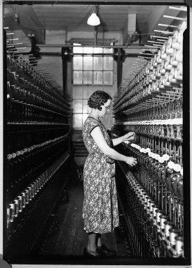 Lewis Wickes Hine (American, 1874-1940). <em>[Untitled]  (Women in Bobbin Aisle)</em>, 1936-1937. Gelatin silver photograph, 7 1/4 x 4 3/4 in. (18.4 x 12.1 cm). Brooklyn Museum, Gift of the National Archives, 79.143.16 (Photo: Brooklyn Museum, 79.143.16_bw.jpg)