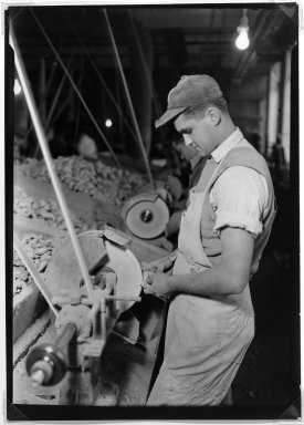 Lewis Wickes Hine (American, 1874-1940). <em>[Untitled]  (Young Man at Lathe)</em>, 1936-1937. Gelatin silver photograph, 7 x 5 in.  (17.8 x 12.7 cm). Brooklyn Museum, Gift of The National Archives, 79.143.28 (Photo: Brooklyn Museum, 79.143.28_bw.jpg)