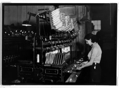 Lewis Wickes Hine (American, 1874-1940). <em>[Untitled]  (Woman at Threading Machine)</em>, 1936-1937. Gelatin silver photograph, 5 x 7 in.  (12.7 x 17.8 cm). Brooklyn Museum, Gift of The National Archives, 79.143.75 (Photo: Brooklyn Museum, 79.143.75_bw.jpg)