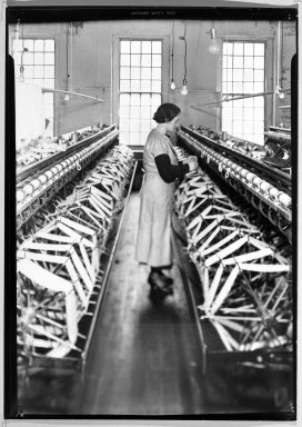 Lewis Wickes Hine (American, 1874-1940). <em>[Untitled]  (Woman between Rows of Skein Wheels)</em>, 1936-1937. Gelatin silver photograph, 7 x 5 in.  (17.8 x 12.7 cm). Brooklyn Museum, Gift of The National Archives, 79.143.81 (Photo: Brooklyn Museum, 79.143.81_bw.jpg)