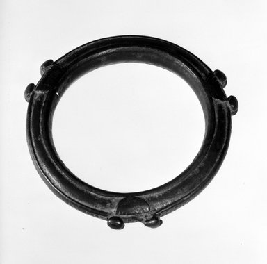 Senufo. <em>Bracelet</em>, late 19th or early 20th century. Copper Alloy, diam: 3 1/4 in. (8.3 cm). Brooklyn Museum, Gift of Dr. and Mrs. Abbott A. Lippman, 79.161.3. Creative Commons-BY (Photo: Brooklyn Museum, 79.161.3_bw.jpg)