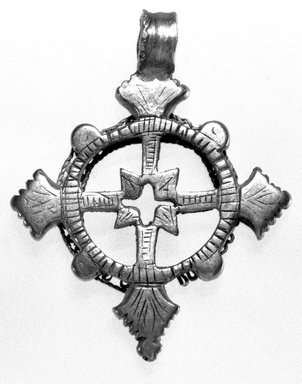 Amhara. <em>Pendant Cross</em>, 19th or 20th century. Silver, 2 x 1 5/8 in. (5.0 x 4.2 cm). Brooklyn Museum, Gift of George V. Corinaldi Jr., 79.72.11. Creative Commons-BY (Photo: Brooklyn Museum, 79.72.11_bw.jpg)