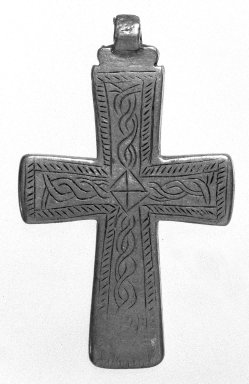 Amhara. <em>Pendant Cross</em>, 19th or 20th century. Silver, 2 1/2 x 1 1/2 in. (6.3 x 3.8 cm). Brooklyn Museum, Gift of George V. Corinaldi Jr., 79.72.16. Creative Commons-BY (Photo: Brooklyn Museum, 79.72.16_bw.jpg)