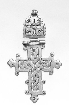 Amhara. <em>Pendant Cross</em>, 19th or 20th century. Silver, 2 5/8 x 1 5/8 in. (6.7 x 4.2 cm). Brooklyn Museum, Gift of George V. Corinaldi Jr., 79.72.21. Creative Commons-BY (Photo: Brooklyn Museum, 79.72.21_bw.jpg)
