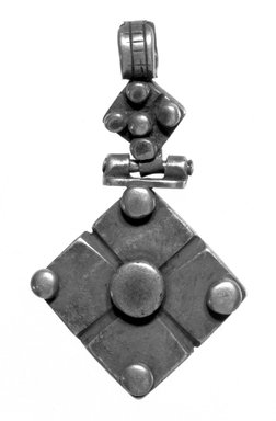 Amhara. <em>Pendant Cross</em>, 19th or 20th century. Silver, 2 1/2 x 1 3/8 in. (6.3 x 3.5 cm). Brooklyn Museum, Gift of George V. Corinaldi Jr., 79.72.25. Creative Commons-BY (Photo: Brooklyn Museum, 79.72.25_bw.jpg)