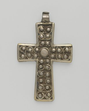 Amhara. <em>Pendant Cross</em>, 19th or 20th century. Silver, 2 1/4 x 1 3/8 in. (5.7 x 3.5 cm). Brooklyn Museum, Gift of George V. Corinaldi Jr., 79.72.27. Creative Commons-BY (Photo: Brooklyn Museum, 79.72.27_front_PS6.jpg)