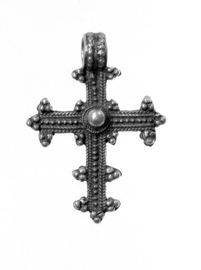 Amhara. <em>Pendant Cross</em>, 19th or 20th century. Silver, 1 7/8 x 1 3/8 in. (4.8 x 3.5 cm). Brooklyn Museum, Gift of George V. Corinaldi Jr., 79.72.28. Creative Commons-BY (Photo: Brooklyn Museum, 79.72.28_view1_bw.jpg)