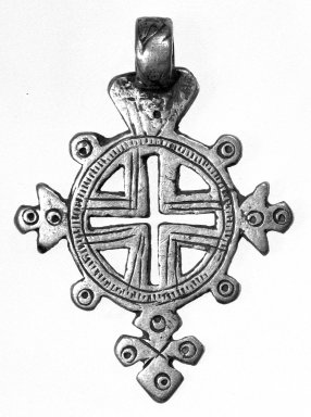Amhara. <em>Pendant Cross</em>, 19th or 20th century. Silver, 1 3/4 x 1 1/4 in. (4.6 x 3.3 cm). Brooklyn Museum, Gift of George V. Corinaldi Jr., 79.72.33. Creative Commons-BY (Photo: Brooklyn Museum, 79.72.33_view1_bw.jpg)