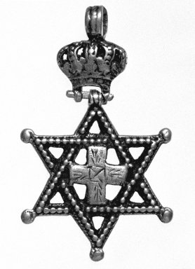Amhara. <em>Pendant Cross with Crown and Star of David</em>, 19th or 20th century. Silver, 2 3/8 x 1 3/8 in. (6.0 x 3.5 cm). Brooklyn Museum, Gift of George V. Corinaldi Jr., 79.72.6. Creative Commons-BY (Photo: Brooklyn Museum, 79.72.6_bw.jpg)