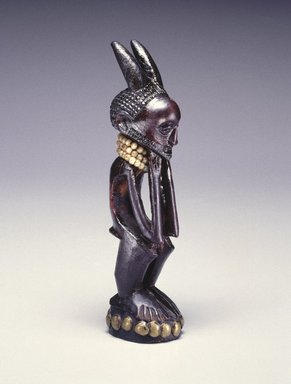 Nsapo-Nsapo. <em>Squatting Male Figure</em>, late 19th century. Wood, copper alloy, glass beads, fiber, organic materials, 7 1/2 x 1 3/4 x 2 in. (19.1 x 4.4 x 5.1 cm). Brooklyn Museum, Purchased with funds given by Frieda and Milton F. Rosenthal and Carll H. de Silver Fund, 80.100. Creative Commons-BY (Photo: Brooklyn Museum, 80.100_threequarter_SL1.jpg)