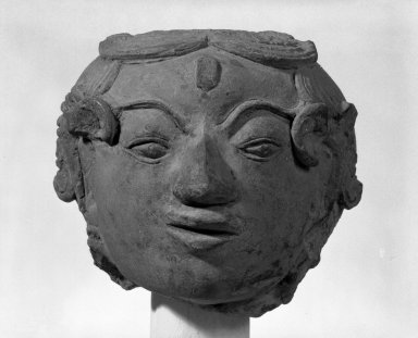 <em>Female Head</em>, 14th century. Terracotta, 6 x 6 x 8 in. (15.2 x 15.2 x 20.3 cm). Brooklyn Museum, Gift of William Bransford Blundin, 80.114. Creative Commons-BY (Photo: Brooklyn Museum, 80.114_bw.jpg)