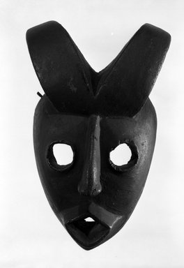 Ogoni. <em>Face Mask with Two Curved Horns</em>, early 20th century. Wood, 9 3/4 x 6 x 4 1/2 in. (24.7 x 15.3 x 11.4 cm). Brooklyn Museum, Gift of Dr. and Mrs. Abbott A. Lippman, 80.152. Creative Commons-BY (Photo: Brooklyn Museum, 80.152_bw.jpg)