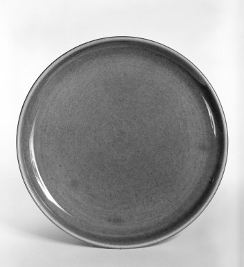 Russel Wright (American, 1904-1976). <em>Plate, from 6-Piece Place Setting</em>, Designed 1937; Manufactured ca. 1938. Earthenware, Diameter: 8 in. (20.3 cm). Brooklyn Museum, Gift of Andrew and Ina Feuerstein, 80.169.3. Creative Commons-BY (Photo: Brooklyn Museum, 80.169.3_bw.jpg)