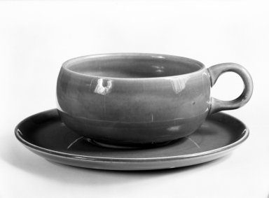 Russel Wright (American, 1904-1976). <em>Cup and Saucer, from 6-Piece Place Setting</em>, Designed 1937; Manufactured ca. 1938. Earthenware, Cup: 2 x 5 x 3 5/8 in. (5.1 x 12.7 x 9.2 cm). Brooklyn Museum, Gift of Andrew and Ina Feuerstein, 80.169.6a-b. Creative Commons-BY (Photo: Brooklyn Museum, 80.169.6a-b_bw.jpg)