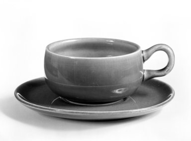 Russel Wright (American, 1904-1976). <em>Cup and Saucer, from 6-Piece Place Setting</em>, Designed 1937; Manufactured ca. 1938. Earthenware, Cup: 1 3/8 x 3 1/2 x 2 1/2 in. (3.5 x 8.9 x 6.4 cm). Brooklyn Museum, Gift of Andrew and Ina Feuerstein, 80.169.7a-b. Creative Commons-BY (Photo: Brooklyn Museum, 80.169.7a-b_bw.jpg)