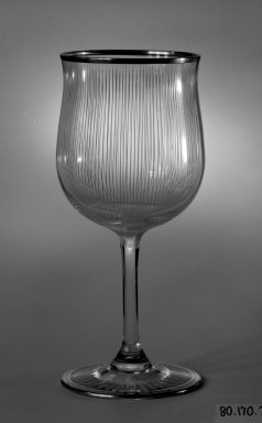 Libby-Owens. <em>Drinking Vessel</em>, ca. 1930. Colorless and blue glass, height: 6 3/4 in. (17.1 cm); diameter: 3 in. (7.6 cm). Brooklyn Museum, Gift of Mrs. Walter Pharr, 80.170.2. Creative Commons-BY (Photo: Brooklyn Museum, 80.170.2_bw.jpg)