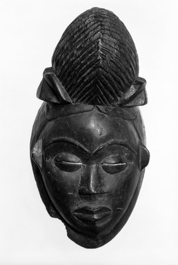 Punu. <em>Mask</em>, late 19th-early 20th century. Wood, 12 3/4 x 5 1/2 x 5 in. (32.3 x 14.0 x 13.0 cm). Brooklyn Museum, Gift of Drs. John I. and Nicole Dintenfass, 80.242. Creative Commons-BY (Photo: Brooklyn Museum, 80.242_bw.jpg)