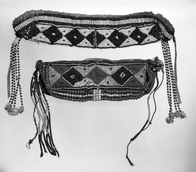 Luba. <em>Beaded Headdress</em>, early 20th century. Cotton, glass beads, cowrie shells, metal, fiber, 14 3/4 x 5 in. (37.5 x 12.7 cm). Brooklyn Museum, Gift of Jay M. Haft, 80.243.14. Creative Commons-BY (Photo: , 80.243.14_80.243.15_bw.jpg)