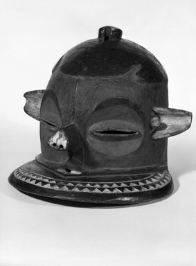 Pende (Eastern). <em>Helmet Mask (Kipoko)</em>, 19th-20th century. Wood, pigment, 9 1/2 x 12 1/2 x 12 1/2 in. (24.0 x 31.0 x 31.0 cm). Brooklyn Museum, Gift of Jay M. Haft, 80.243.17. Creative Commons-BY (Photo: Brooklyn Museum, 80.243.17_bw.jpg)