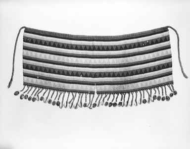 Kirdi (ie. Gisinga, Motu, Gude, Glidder, Fali). <em>Cache Sexe/Apron</em>, late 19th or early 20th century. Cotton fiber, glass beads, cowrie shells, metal, fiber, 21 × 10 1/2 in. (53.3 × 26.7 cm). Brooklyn Museum, Gift of Jay M. Haft, 80.243.2. Creative Commons-BY (Photo: Brooklyn Museum, 80.243.2_bw.jpg)
