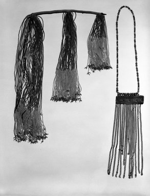Kirdi (ie. Gisinga, Motu, Gude, Glidder, Fali). <em>Cache Sexe/Apron</em>, late 19th or early 20th century. Cotton, glass beads, cowrie shells, metal, fiber, 24 1/2 x 3 3/4 in. (62.2 x 9.5 cm). Brooklyn Museum, Gift of Jay M. Haft, 80.243.5. Creative Commons-BY (Photo: , 80.243.4_80.243.5_bw.jpg)