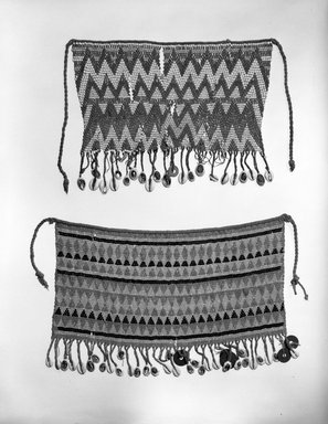 Kirdi (ie. Gisinga, Motu, Gude, Glidder, Fali). <em>Cache Sexe/Apron</em>, early to mid 20th century. Cotton, glass beads, cowrie shells, metal, fiber, 9 1/2 x 13 in. (24.1 x 33 cm). Brooklyn Museum, Gift of Jay M. Haft, 80.243.7. Creative Commons-BY (Photo: , 80.243.6_80.243.7_bw.jpg)