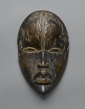 Dan. <em>Dean Gle Mask</em>, late 19th-early 20th century. Wood, pigment, 9 3/4 x 6 x 3 in. (24.8 x 15.2 x 7.6 cm). Brooklyn Museum, Gift of Evelyn K. Kossak, 80.244. Creative Commons-BY (Photo: Brooklyn Museum, 80.244_PS2.jpg)